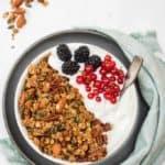 Bowl of homemade pumpkin seed granola with yogurt and fruit