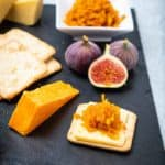 Cheese platter with crackers and carrot chutney