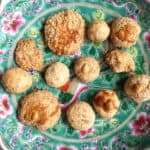 12 types of Chinese peanut cookies made from 12 different recipes on a plate