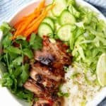 A bowl of lemongrass grilled chicken with vegetables