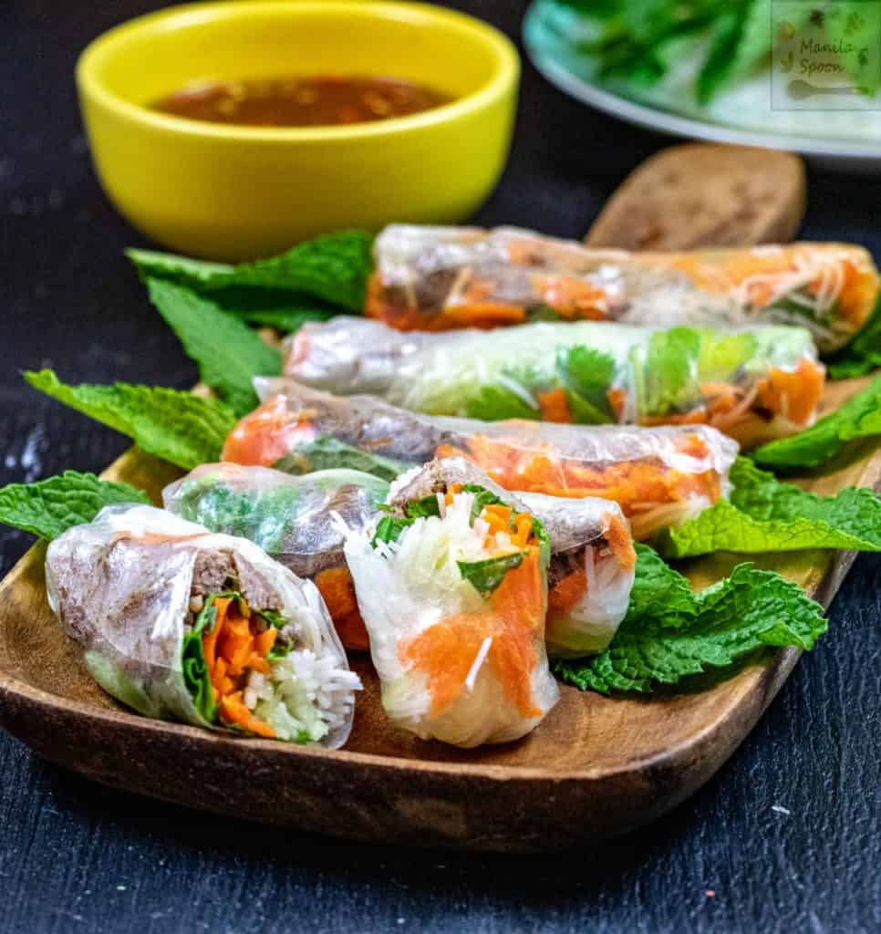 A plate filled with Vietnamese fresh spring rolls