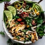 Bowl of Thai chicken salad and greens