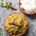 A bowl of curry leaf tomato chutney and rice