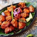 A platter of chicken baked with curry leaves