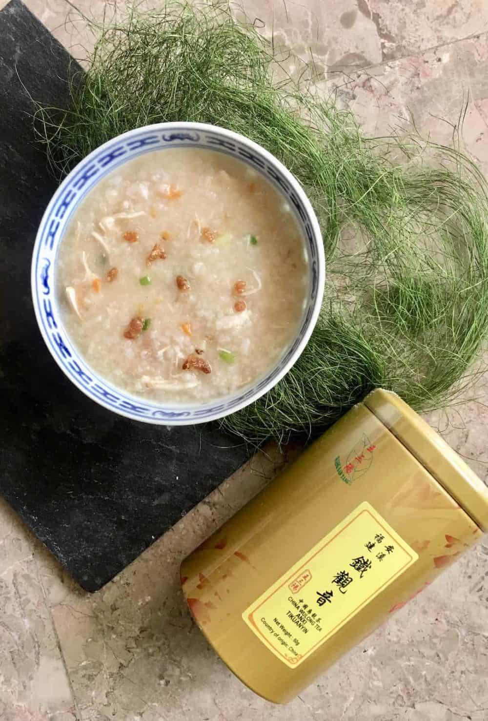A bowl of chicken rice porridge and tea