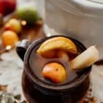 A mug of Mexican Christmas punch made with fruits and tamarind