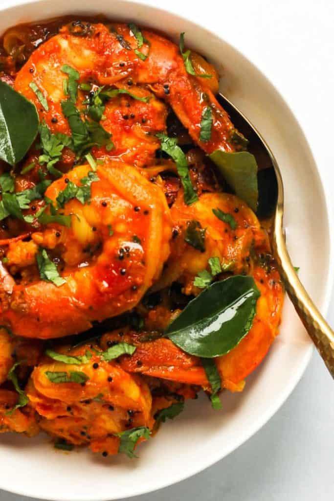 A close up of a bowl of malabar shrimp stew