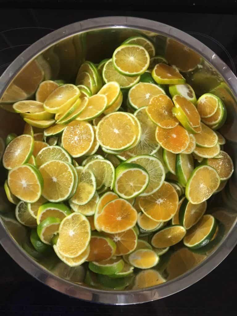 A bowl of sliced Korean green tangerines used to make cheong